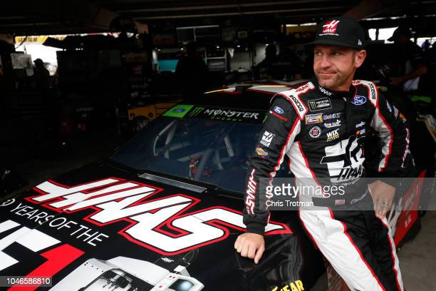 Clint Bowyer driver of the Haas VF1/Rush Truck Centers Ford stands in the garage area during practice for the Monster Energy NASCAR Cup Series Gander...