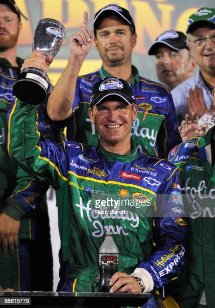 Clint Bowyer, driver of the Holiday Inn Chevrolet, celebrates in victory lane after winning the NASCAR Nationwide Series Subway Jalapeno 250 at...