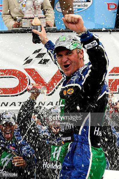 Clint Bowyer driver of the Holiday Inn Chevrolet celebrates with his crew in victory lane after winning the NASCAR Nationwide Series Dover 200 at...