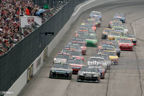 Clint Bowyer, driver of the Jack Daniel's Chevrolet, leads Greg Biffle, driver of the Ameriquest Ford, and the rest of field to the green flag to...