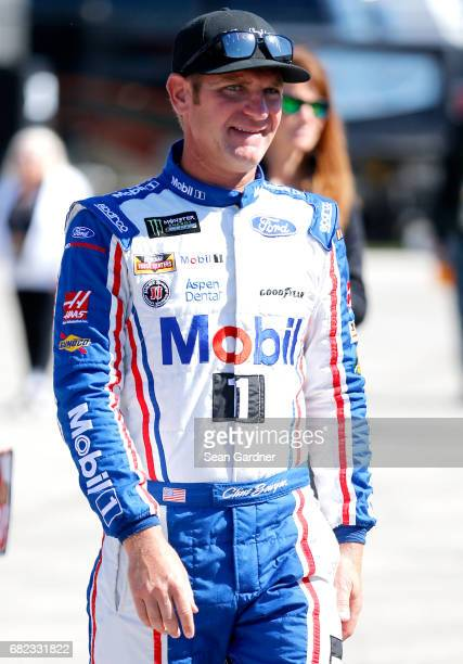 Clint Bowyer driver of the Mobil 1 Annual Protection Ford walks through the garage area during practice for the Monster Energy NASCAR Cup Series Go...