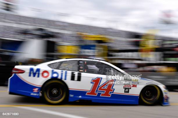 Clint Bowyer driver of the Mobil 1 Ford drives through the garage during practice for the Monster Energy NASCAR Cup Series 59th Annual DAYTONA 500 at...