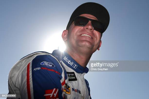 Clint Bowyer driver of the Mobil 1 Ford sits on pit wall during qualifying for the Monster Energy NASCAR Cup Series 59th Annual DAYTONA 500 at...