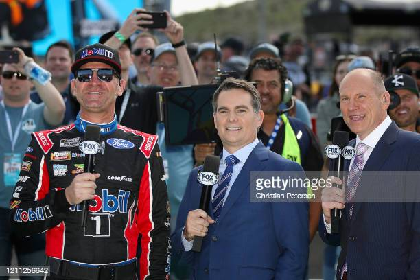 Clint Bowyer, driver of the Mobil 1/Haas CNC Ford, Hall of Fame driver and TV commentator Jeff Gordon and Fox broadcast Adam Alexander before the...