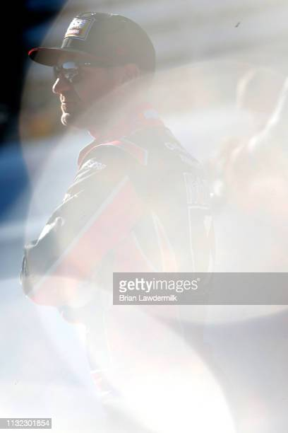Clint Bowyer driver of the Mobil 1/Rush Truck Centers Ford stands on the grid during qualifying for the Monster Energy NASCAR Cup Series STP 500 at...