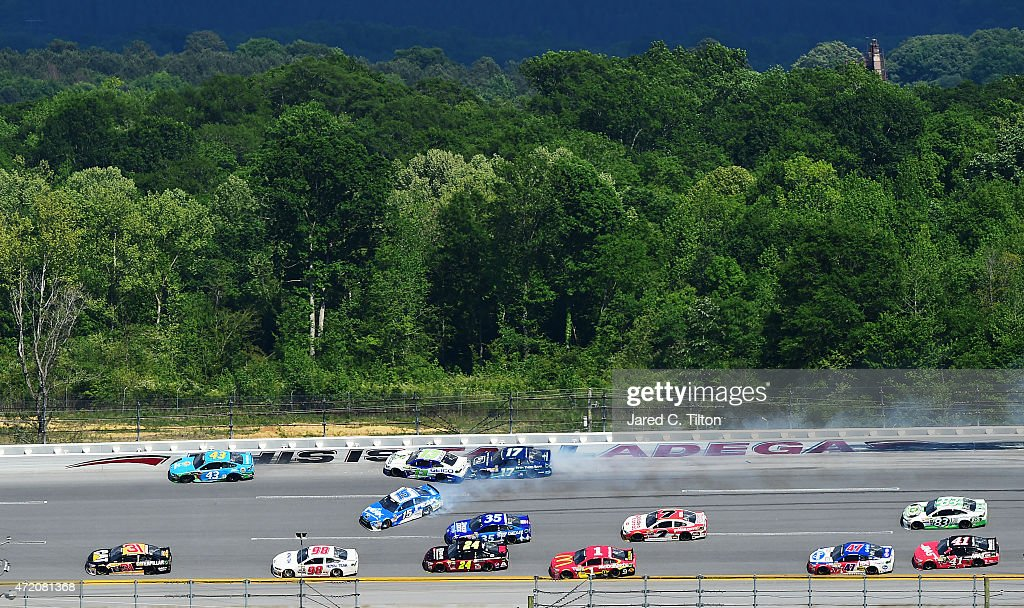 Clint Bowyer, driver of the #15 PEAK Commercial & Industrial Toyota, Casey Mears, driver of the #13 GEICO Chevrolet, and Ricky Stenhouse Jr., driver of the #17 Fifth Third Bank Ford, wreck during the NASCAR Sprint Cup Series GEICO 500 at Talladega Superspeedway on May 3, 2015 in Talladega, Alabama.