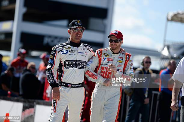 Clint Bowyer, driver of the RK Motors Charlotte Toyota, \and Dale Earnhardt Jr., driver of the National Guard Chevrolet, stand on the grid during...
