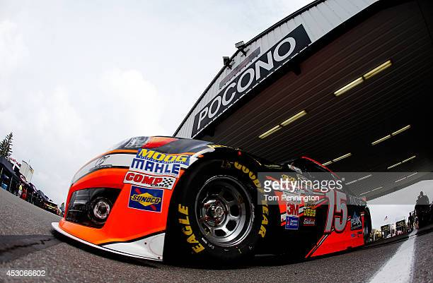 Clint Bowyer driver of the RK Motors Charlotte Toyota drives during practice for the NASCAR Sprint Cup Series GoBowlingcom 400 at Pocono Raceway on...