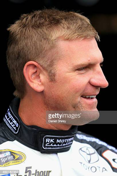 Clint Bowyer, driver of the RK Motors Charlotte Toyota, looks on in the garage area during practice for the NASCAR Sprint Cup Series Pocono 400 at...