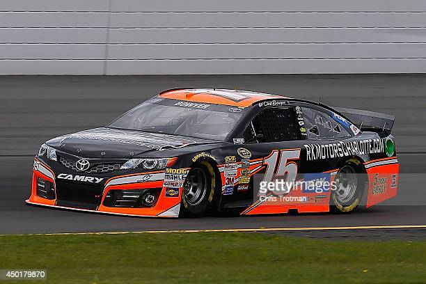 Clint Bowyer, driver of the RK Motors Charlotte Toyota, practices for the NASCAR Sprint Cup Series Pocono 400 at Pocono Raceway on June 6, 2014 in...