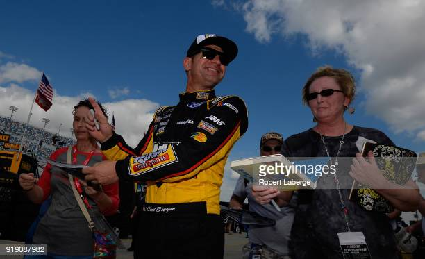 Clint Bowyer driver of the Rush Truck Centers Ford signs autographs during practice for the Monster Energy NASCAR Cup Series Daytona 500 at Daytona...