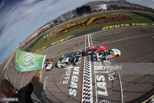 Clint Bowyer driver of the Toco Warranty Ford takes the green flag to start the Monster Energy NASCAR Cup Series South Point 400 at Las Vegas Motor...