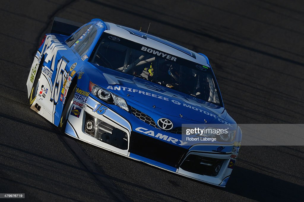 Clint Bowyer drives the #15 PEAK Toyota during qualifying for the NASCAR Sprint Cup Series Auto Club 400 at Auto Club Speedway on March 21, 2014 in Fontana, California.