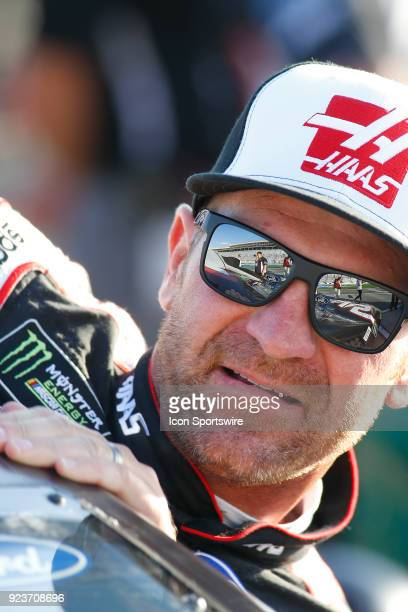 Clint Bowyer StewartHaas Racing Haas Automation Ford Fusion climbs in his car during qualifying for the Folds of Honor QuikTrip 500 Monster Energy...