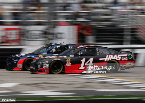 Clint Bowyer StewartHass Racing Haas Automation Ford Fusion Alex Bowman Hendrick Motorsports Axalta Chevrolet Camaro during the running of the 59th...