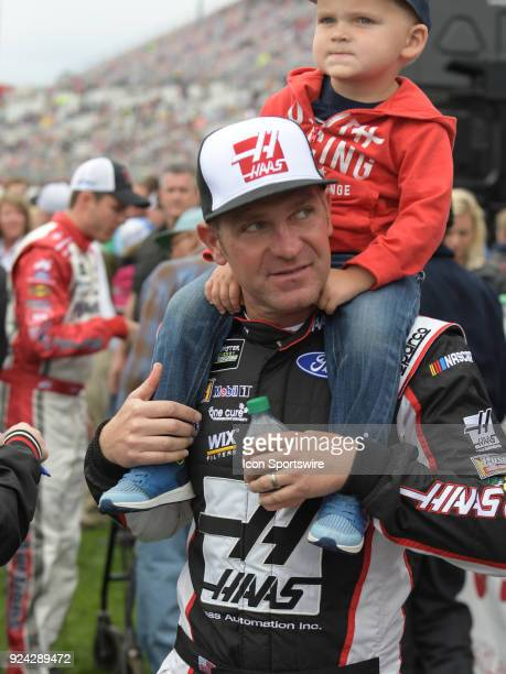 Clint Bowyer StewartHass Racing Haas Automation Ford Fusion and his son Cash before the Monster Energy Cup Series Folds of Honor Quiktrip 500 on...