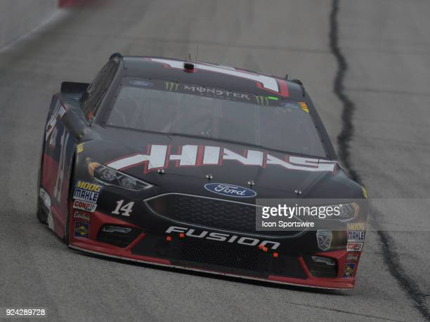 Clint Bowyer StewartHass Racing Haas Automation Ford Fusion racing through the corner during the Monster Energy Cup Series Folds of Honor Quiktrip...