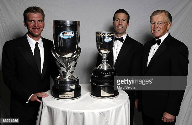 Clint Boyer JD Gibbs and Joe Gibbs poses for photos at the NASCAR Nationwide banquet at the Portafino Hotel on November 22 2008 in Orlando Florida