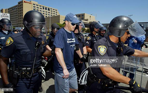 Clint Buttler of Sacramento is detained by police after the Secret Service pulled him out of the crowd on suspicion of carrying weapons at a...