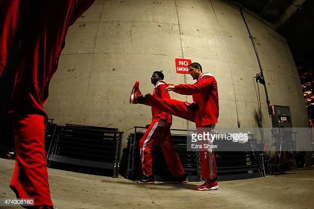 Clint Capela and Pablo Prigioni of the Houston Rockets warm up before taking the court for game two against the Golden State Warriors of the Western...