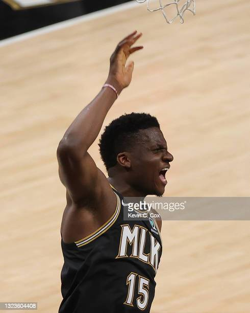 Clint Capela of the Atlanta Hawks reacts after dunking against the Philadelphia 76ers during the second half of game 4 of the Eastern Conference...