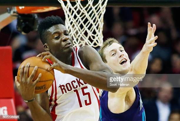 Clint Capela of the Houston Rockets and Cody Zeller of the Charlotte Hornets battle for the basketball during their game at Toyota Center on December...