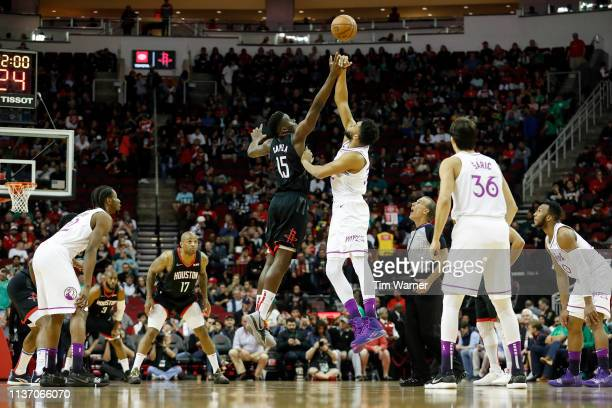 Clint Capela of the Houston Rockets and KarlAnthony Towns of the Minnesota Timberwolves battle for the opening tip off in the first quarter at Toyota...