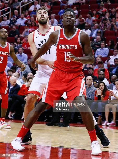 Clint Capela of the Houston Rockets blocks out Jonas Valanciunas of the Toronto Raptors at Toyota Center on November 14 2017 in Houston Texas NOTE TO...