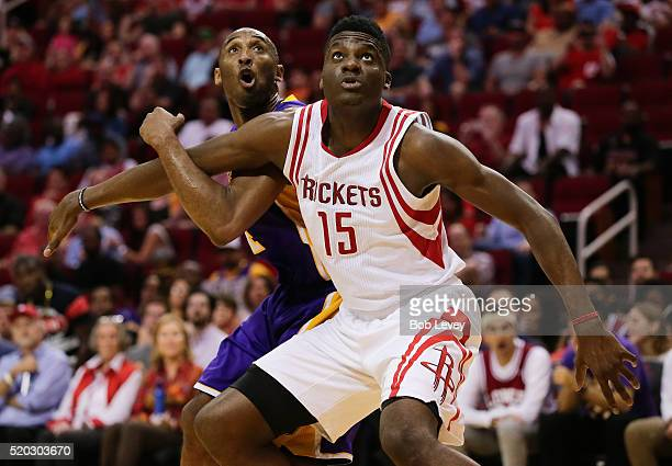 Clint Capela of the Houston Rockets blocks out Kobe Bryant of the Los Angeles Lakers duiring a free throw attempt at Toyota Center on April 10 2016...