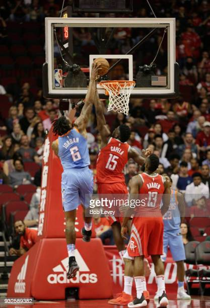 Clint Capela of the Houston Rockets blocks the dunk attemp of DeAndre Jordan of the LA Clippers as James Harden looks at Toyota Center on March 15...
