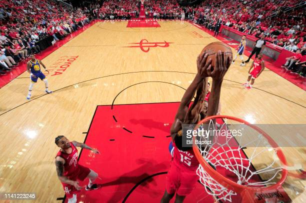 Clint Capela of the Houston Rockets blocks the shot by Andre Iguodala of the Golden State Warriors during Game Three of the Western Conference...