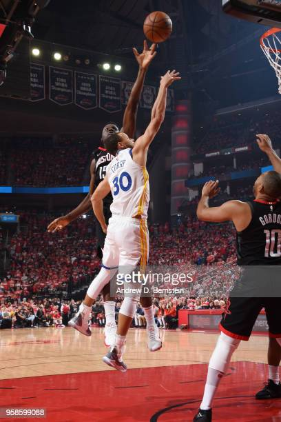 Clint Capela of the Houston Rockets blocks the shot by Stephen Curry of the Golden State Warriors during Game One of the Western Conference Finals of...