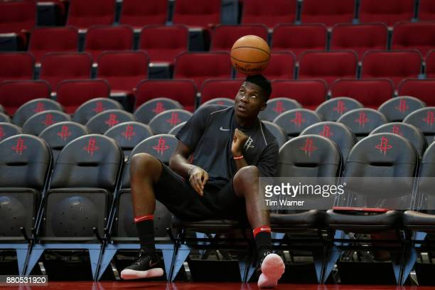 Clint Capela of the Houston Rockets bounces a ball on his head before the game against the Brooklyn Nets at Toyota Center on November 27 2017 in...
