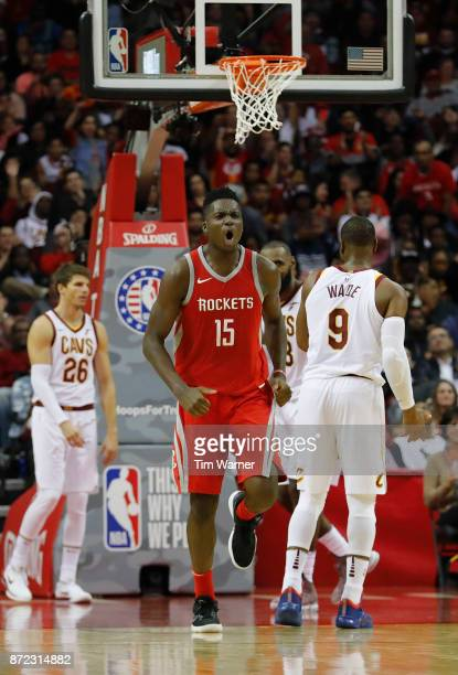 Clint Capela of the Houston Rockets celebrates after dunking the ball in the fourth quarter against the Cleveland Cavaliers at Toyota Center on...