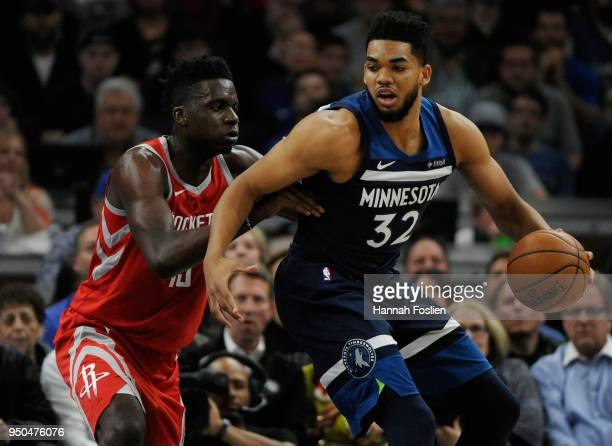 Clint Capela of the Houston Rockets defends against KarlAnthony Towns of the Minnesota Timberwolves during the second quarter in Game Four of Round...