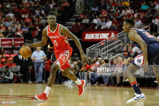 Clint Capela of the Houston Rockets dribbles the ball defended by Ian Mahinmi of the Washington Wizards in the first half at Toyota Center on April 3...