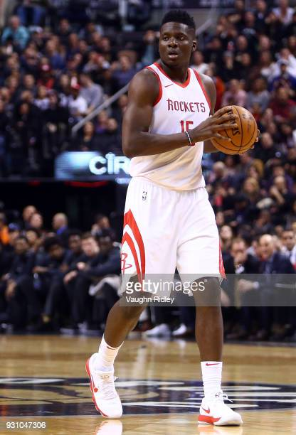 Clint Capela of the Houston Rockets dribbles the ball during the first half of an NBA game against the Toronto Raptors at Air Canada Centre on March...