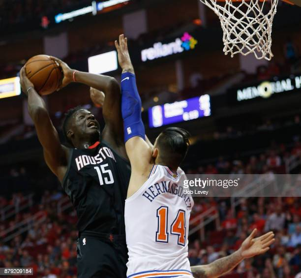 Clint Capela of the Houston Rockets drives on Willy Hernangomez of the New York Knicks at Toyota Center on November 25 2017 in Houston Texas NOTE TO...