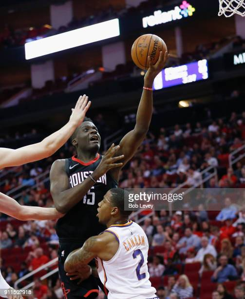 Clint Capela of the Houston Rockets drives over Isaiah Canaan of the Phoenix Suns in the fourth quarter at Toyota Center on January 28 2018 in...