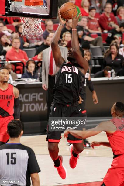 Clint Capela of the Houston Rockets drives to the basket against the Portland Trail Blazers on December 9 2017 at the Moda Center in Portland Oregon...