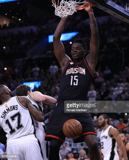Clint Capela of the Houston Rockets dunks against Jonathon Simmons and Pau Gasol of the San Antonio Spurs during Game Two of the NBA Western...