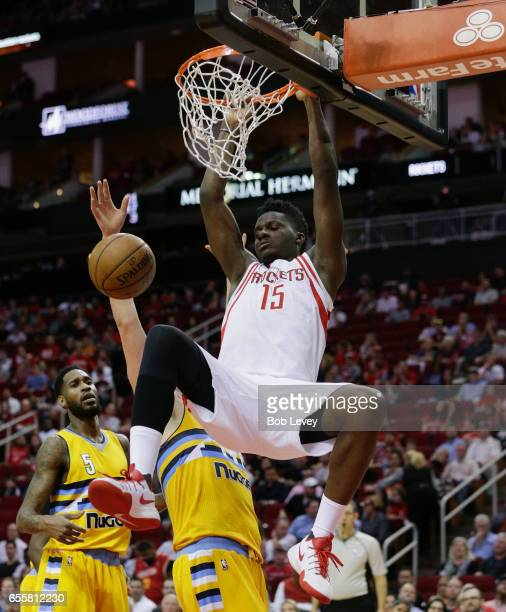 Clint Capela of the Houston Rockets dunks during the second quarter against the Denver Nuggets at Toyota Center on March 20 2017 in Houston Texas...
