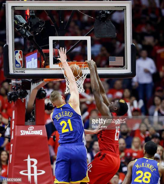 Clint Capela of the Houston Rockets dunks on Jonas Jerebko of the Golden State Warriors and Alfonzo McKinnie during Game Six of the Western...