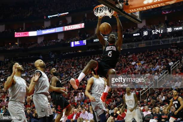 Clint Capela of the Houston Rockets dunks the ball against Derrick Rose of the Minnesota Timberwolves and KarlAnthony Towns in the first half during...