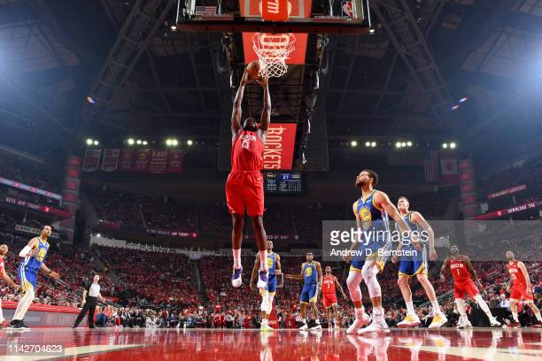 Clint Capela of the Houston Rockets dunks the ball against the Golden State Warriors during Game Six of the Western Conference Semifinals of the 2019...