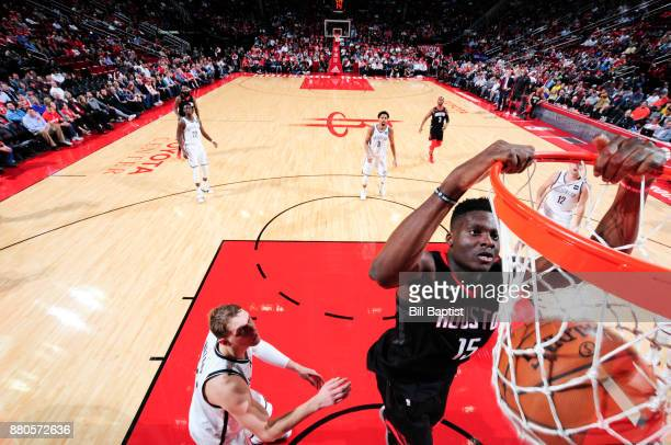 Clint Capela of the Houston Rockets dunks the ball against the Brooklyn Nets on November 27 2017 at the Toyota Center in Houston Texas NOTE TO USER...