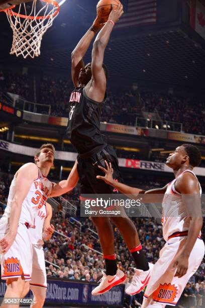 Clint Capela of the Houston Rockets dunks the ball during the game against the Phoenix Suns on January 12 2018 at Talking Stick Resort Arena in...