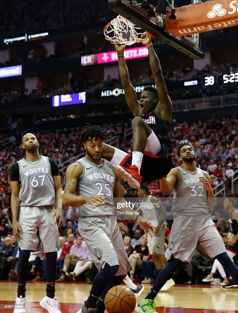Clint Capela #15 of the Houston Rockets dunks the ball over Derrick Rose #25 of the Minnesota Timberwolves and Karl-Anthony Towns #32 in the first half during Game One of the first round of the 2018 NBA Playoffs at Toyota Center on April 15, 2018 in Houston, Texas.