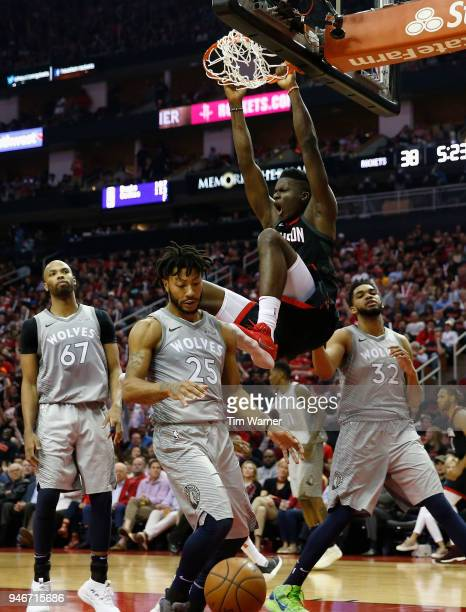 Clint Capela of the Houston Rockets dunks the ball over Derrick Rose of the Minnesota Timberwolves and KarlAnthony Towns in the first half during...