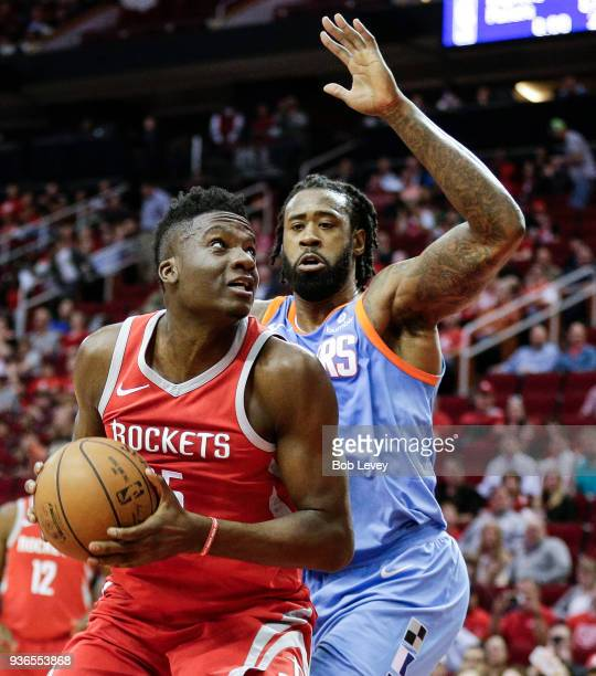 Clint Capela of the Houston Rockets eyes the basket as DeAndre Jordan of the LA Clippers defends at Toyota Center on March 15 2018 in Houston Texas...